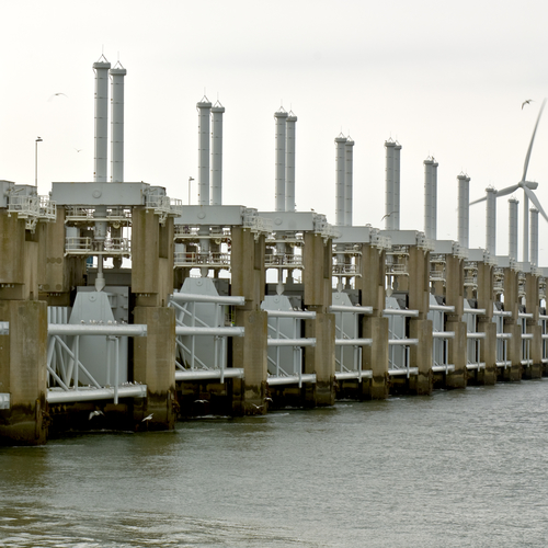Seagulls surrounding the high tech water management and protection structure of the Oosterschelde Storm flood barrier