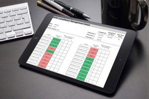 hotel compliance manager looking at compliance report on iPad